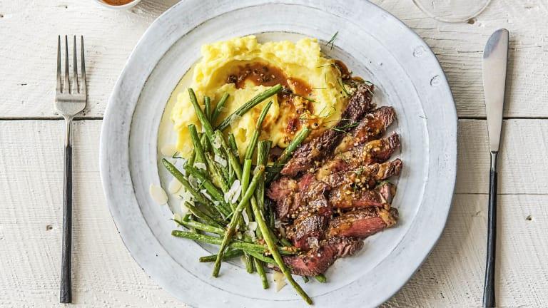 Strip Steak Over Truffled Mashed Potatoes