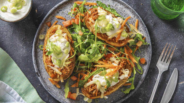 Cheat's Loaded Pork Jacket Potatoes with Sour Cream and Rocket Salad