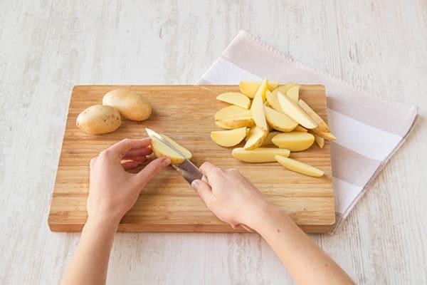 Slice the potato into wedges