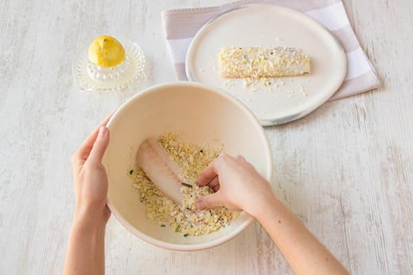 Roll barramundi fillets in crumb mix