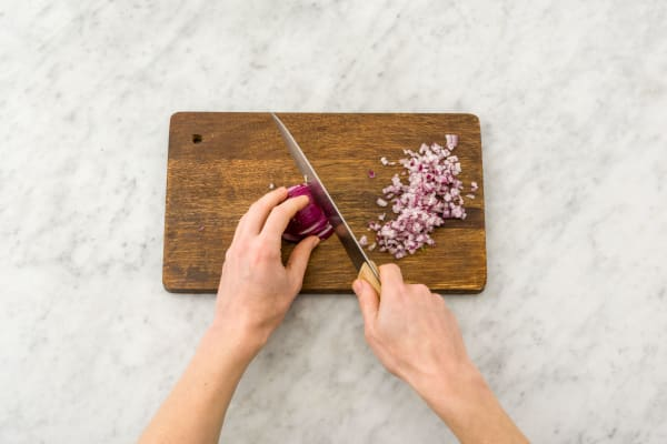 Peel and chop red onion and garlic.