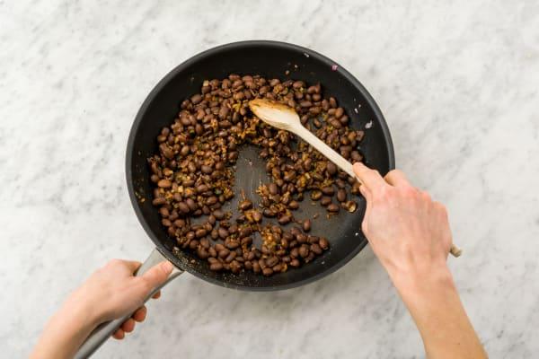 Cook beans.