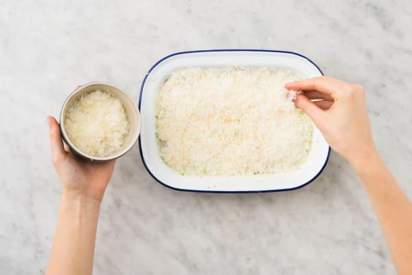Met kaas bestrooien