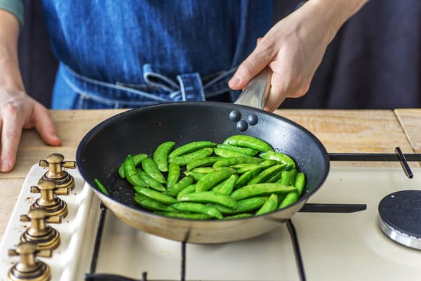 Stir fry the sugar snaps