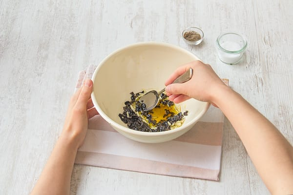 Make the black olive-sherry vinaigrette
