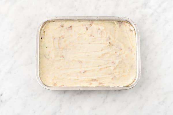 Cover chicken with mash potato.