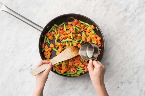 Cook veggies.