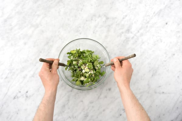 Toss the arugula with the dressing