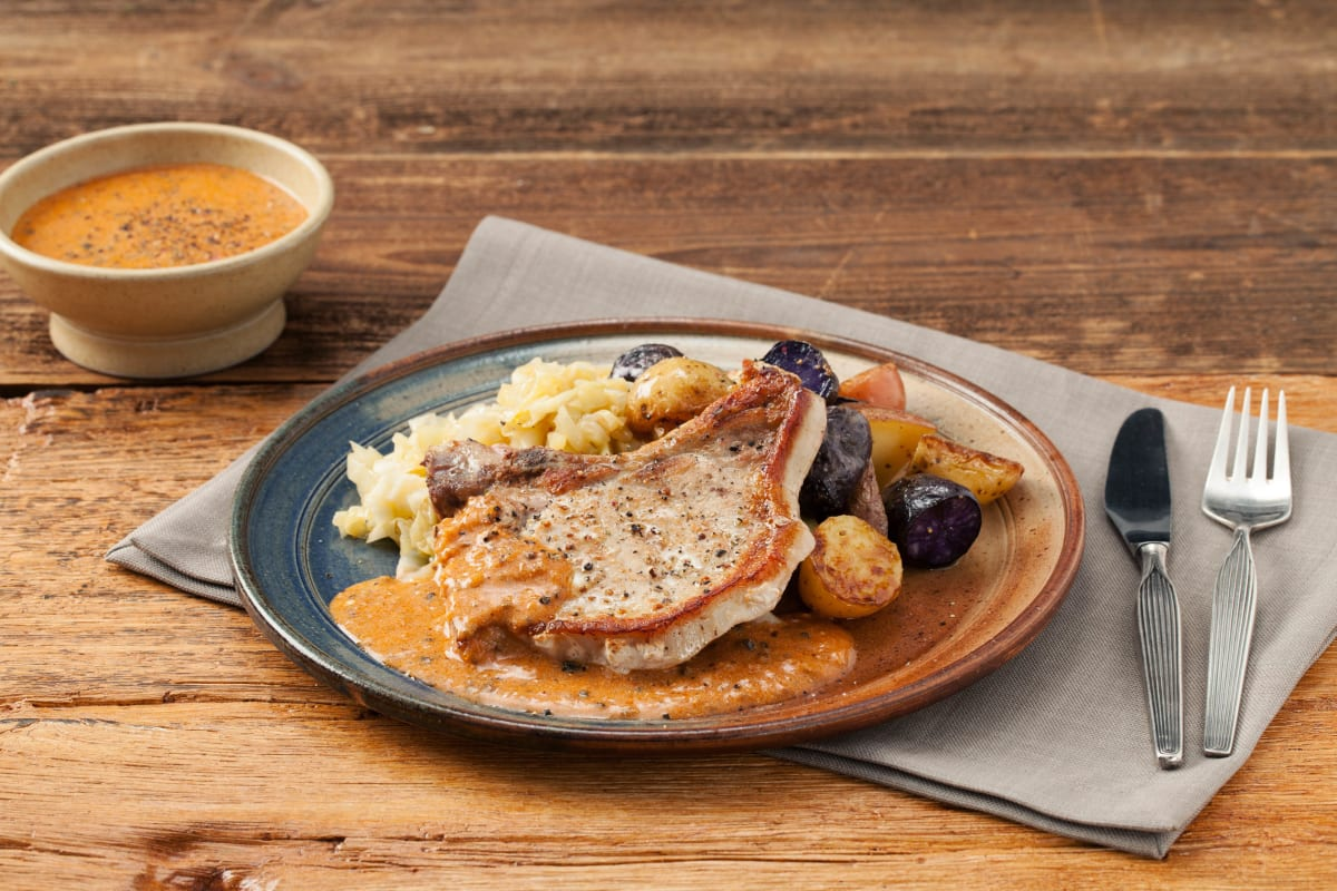 Bone-In Pork Chops with Shallot-Peppercorn Sauce, Butter-Braised Cabbage, and Crispy Potatoes