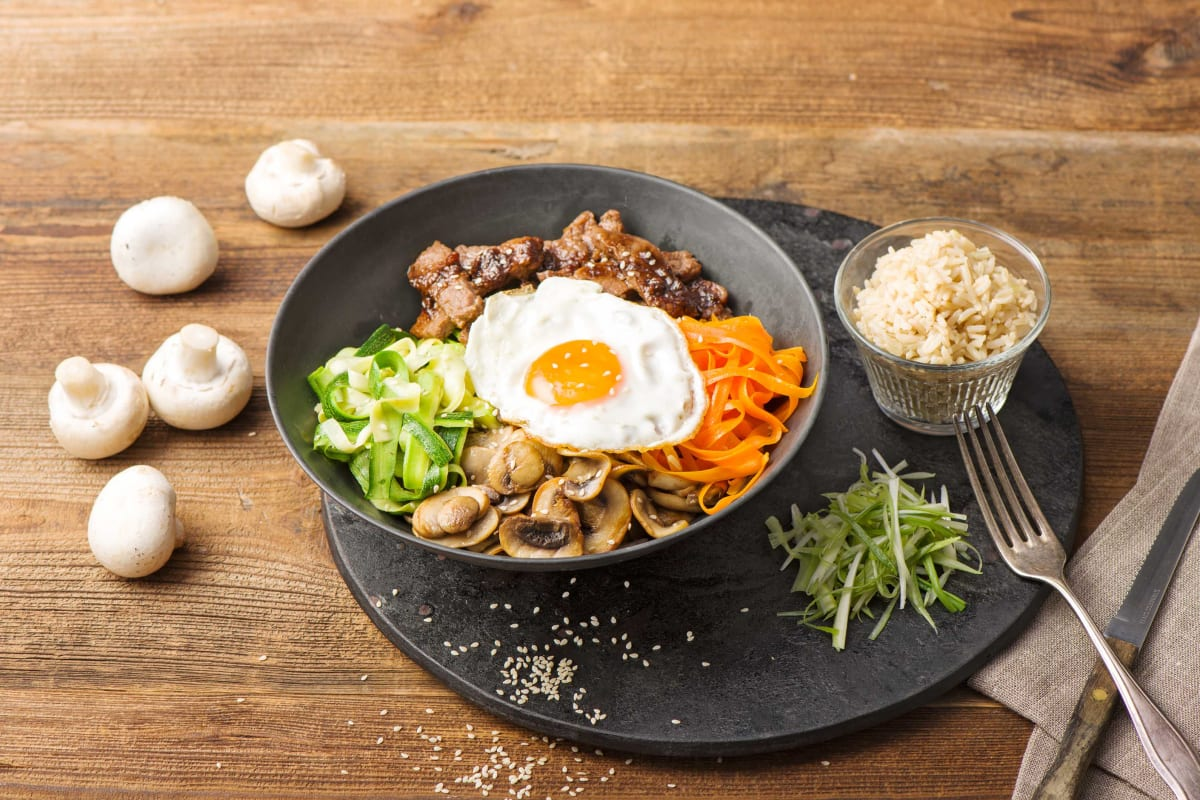 Marinated Steak Bibimbap with Shaved Vegetables, Crispy Mushrooms, and Pickled Scallions