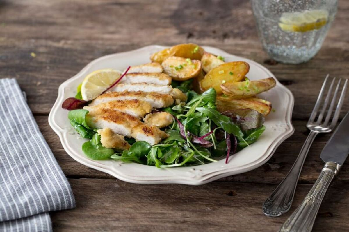 Chicken Milanese with Crispy Potatoes, Mixed Greens, and Creamy Lemon-Chive Dressing