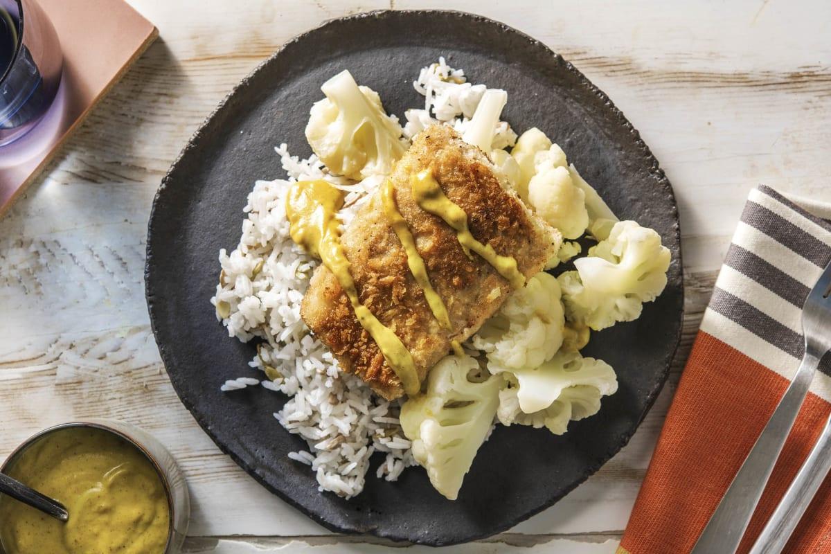 Filet de merlu pané accompagné de chou-fleur et d'une sauce au curry