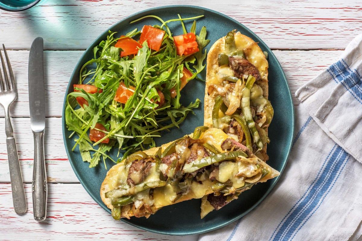 Baguette au bœuf émincé, aux poivrons et au fromage