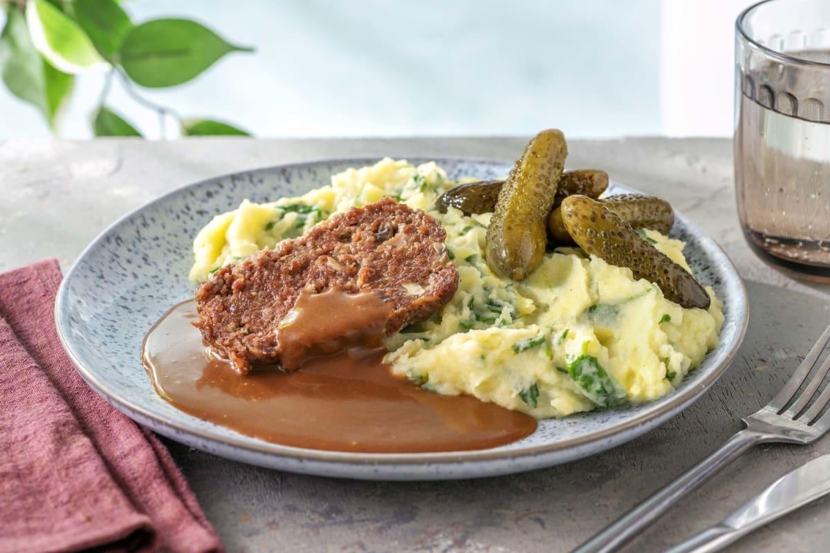 Pain de viande bœuf avec une purée d'épinards