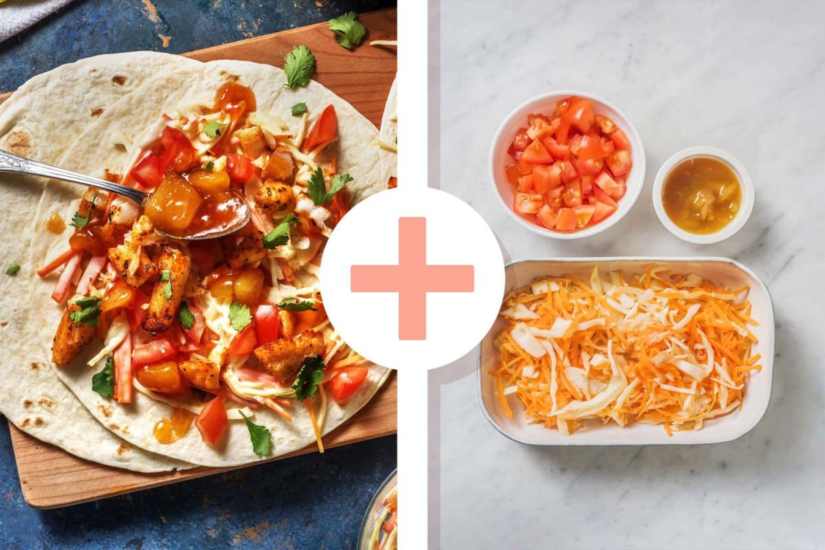 Mexicaanse viswraps met dubbele portie salade en tomaat