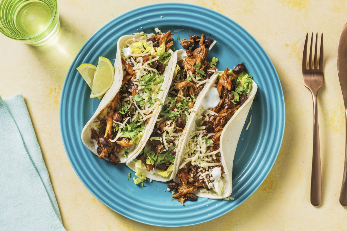 Cheesy Pulled Chicken & Black Bean Tacos