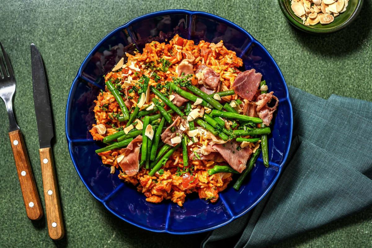 Rijst in tomatenroomsaus met serranoham