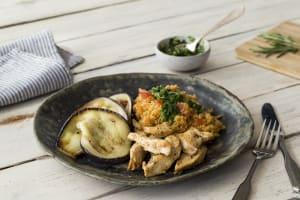 Couscous met gemarineerde kipfiletreepjes en rucoladressing image