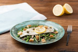 Sole en Papillote with Mushrooms, Croutons, and Brown-Butter Caper Sauce image