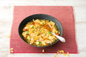 Alexis' Tortilla Soup with Sweet Corn, Avocado, and Cheddar image