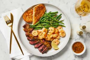 Steak au Poivre & Garlic Herb Shrimp image
