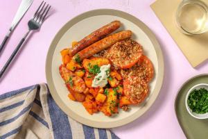 Pittige aardappeltjes met harissa en varkensworstjes image