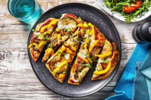 Naanpizza met aubergine en mozzarella image