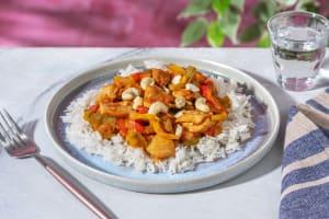 Poulet en sauce aigre-douce avec du poivron, de l'ananas et du riz image