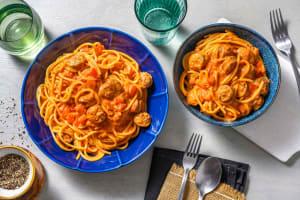 Spaghetti met kipworst en rode pesto image