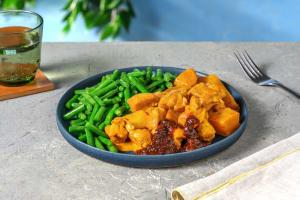 Poulet aux épices, haricots et pommes de terre image