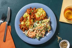 Veganes Pulled in BBQ-Marinade auf Ofenkartoffel image
