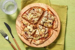 Platbroodpizza met drie kazen en courgette image
