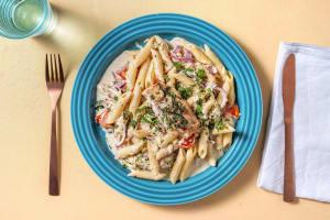 Gemarineerde kabeljauw met pasta in roomsaus image