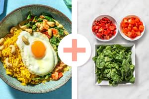 Curry d'épinards à la noix de coco avec riz jaune et œuf au plat image