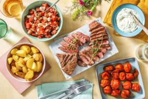 Bavette, pommes de terre en papillote et  tomates cerises cuisinées au vinaigre balsamique image