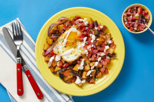 Cheesy Fried Eggs over Nacho Potato Hash image