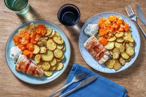 Schelvis in ontbijtspek met gebakken wortelschijfjes image