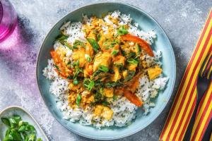 Mildes Fischcurry mit Tomaten und Spinat image