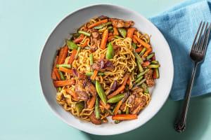 Nouilles sautées au poulet & légumes asiatiques image