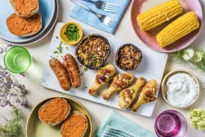 Planche BBQ avec saucisses Brandt & Levie et pilons de poulet image