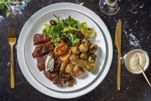 Biefstuk met blauwekaasboter en knoflookspruitjes image