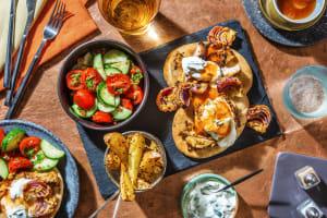Tandoori Style Chicken on Naans with Raita and Mango Chutney image