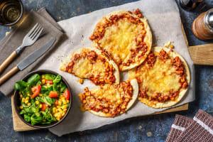 Tostada met gekruid kipgehakt en cheddar image