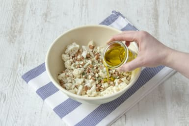 Toss cauliflower florets with almonds, za'atar, and olive oil in a bowl