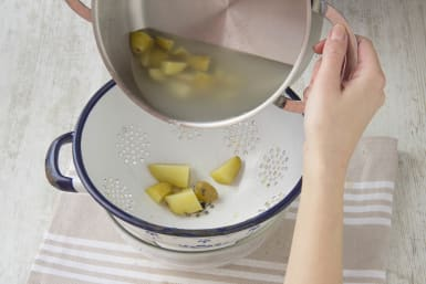 Boil and drain the potatoes