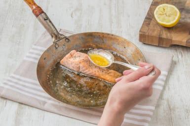 Spoon the lemon juice over the salmon