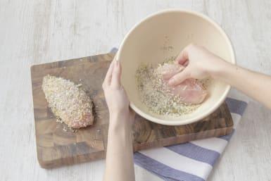 Coat chicken breast in breadcrumbs