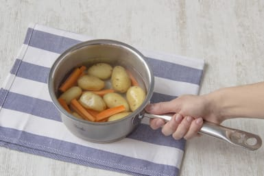 Cook potatoes with carrots