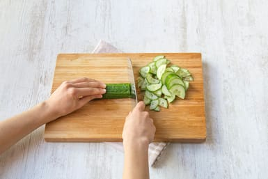 Half and thinly slice the cucumber