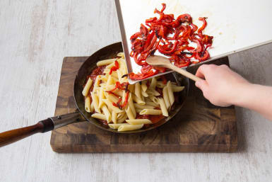 Add penne to the sauce